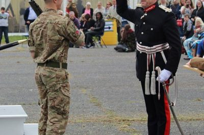 The Lord-Lieutenant salutes Cadet Regimental Sergeant Major Teddy Hukins