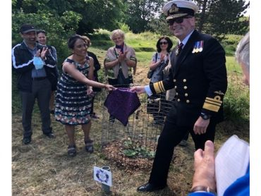 Vice Admiral Allan Richards DL installs a Plaque at the NHS Fig Tree