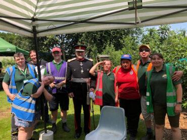 The Lord-Lieutenant presents the QAVS award to Sunnyside Rural Trust